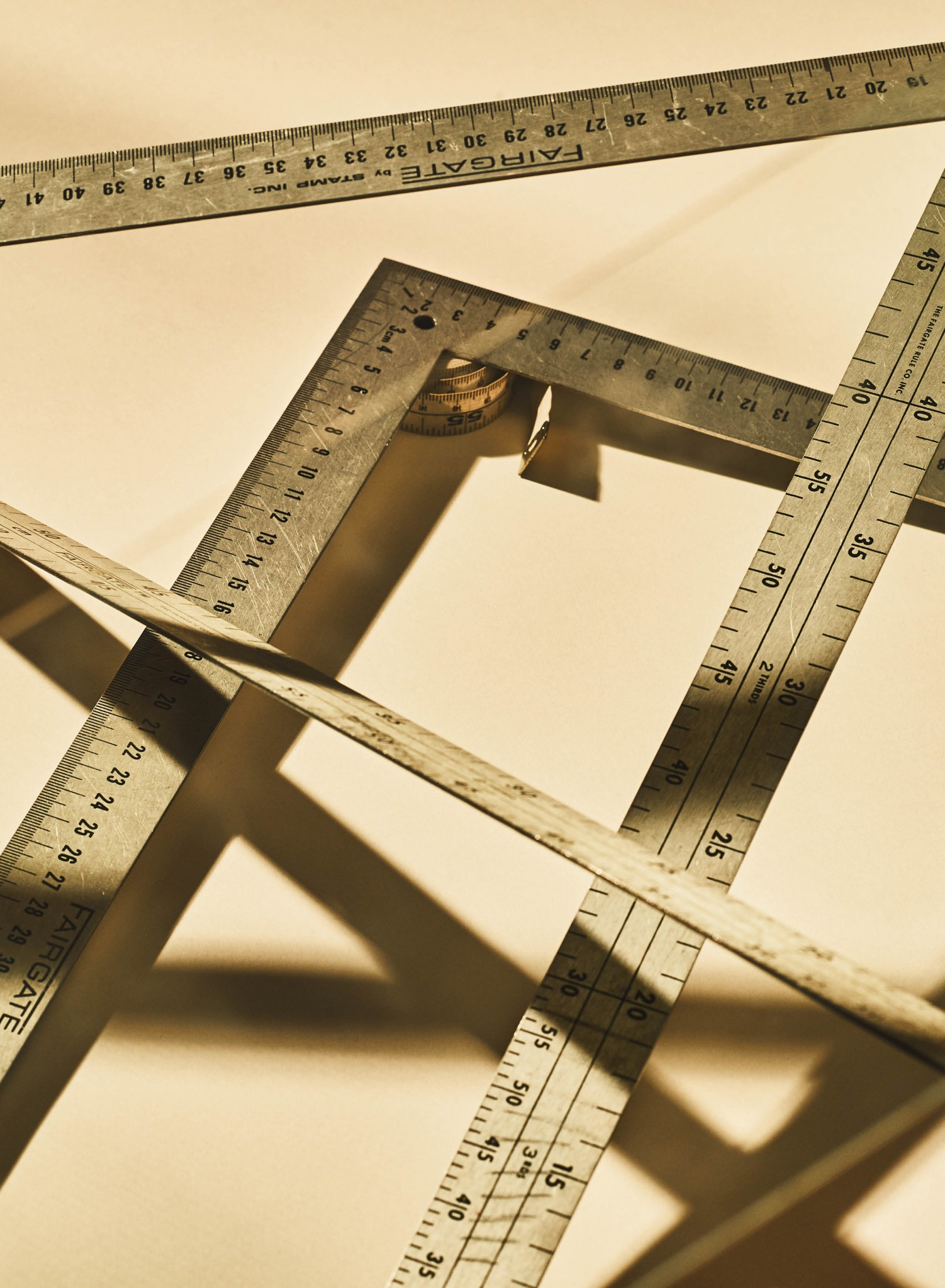 Closeup image of metal rulers and a tape measure