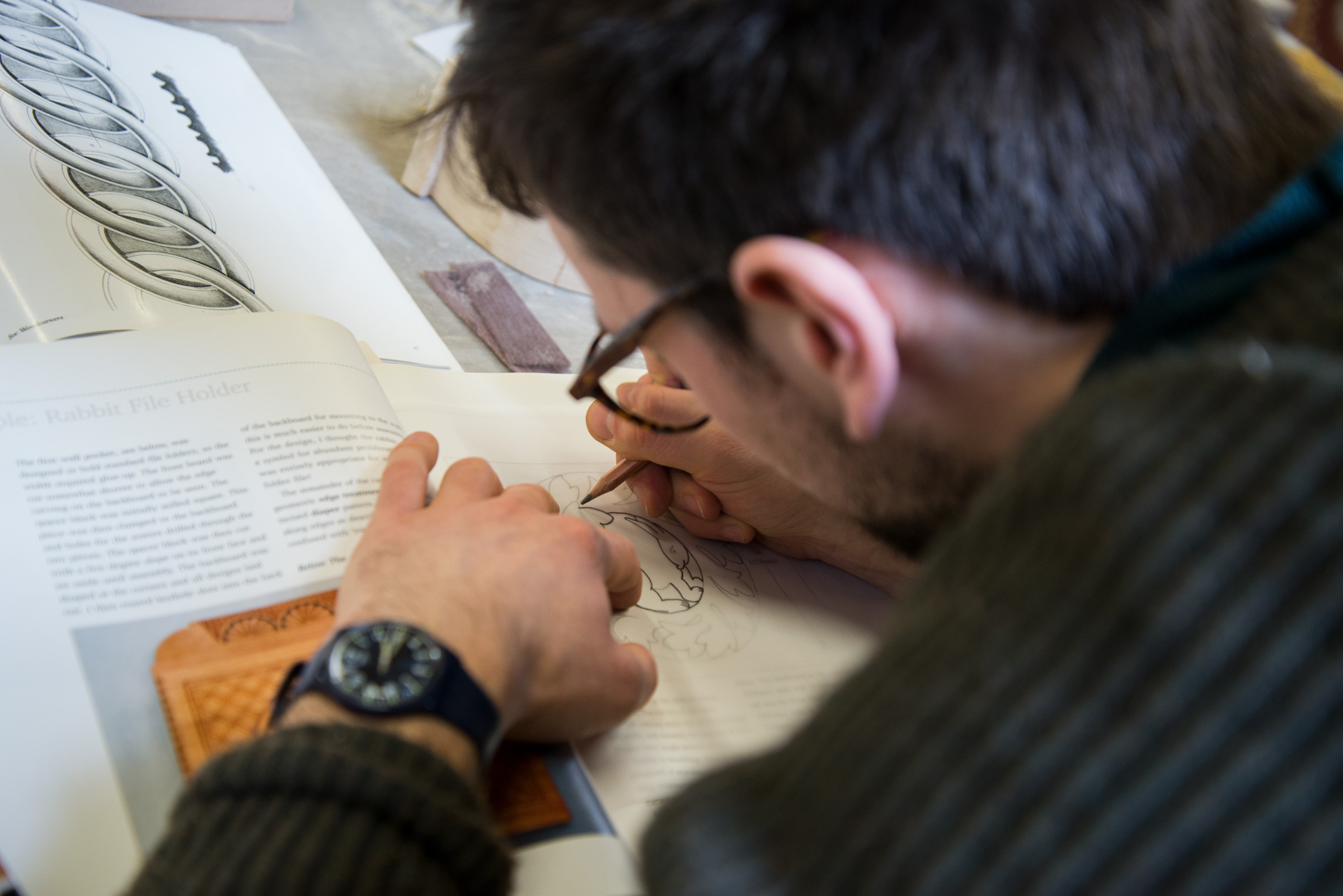 Close up image of a man drawing