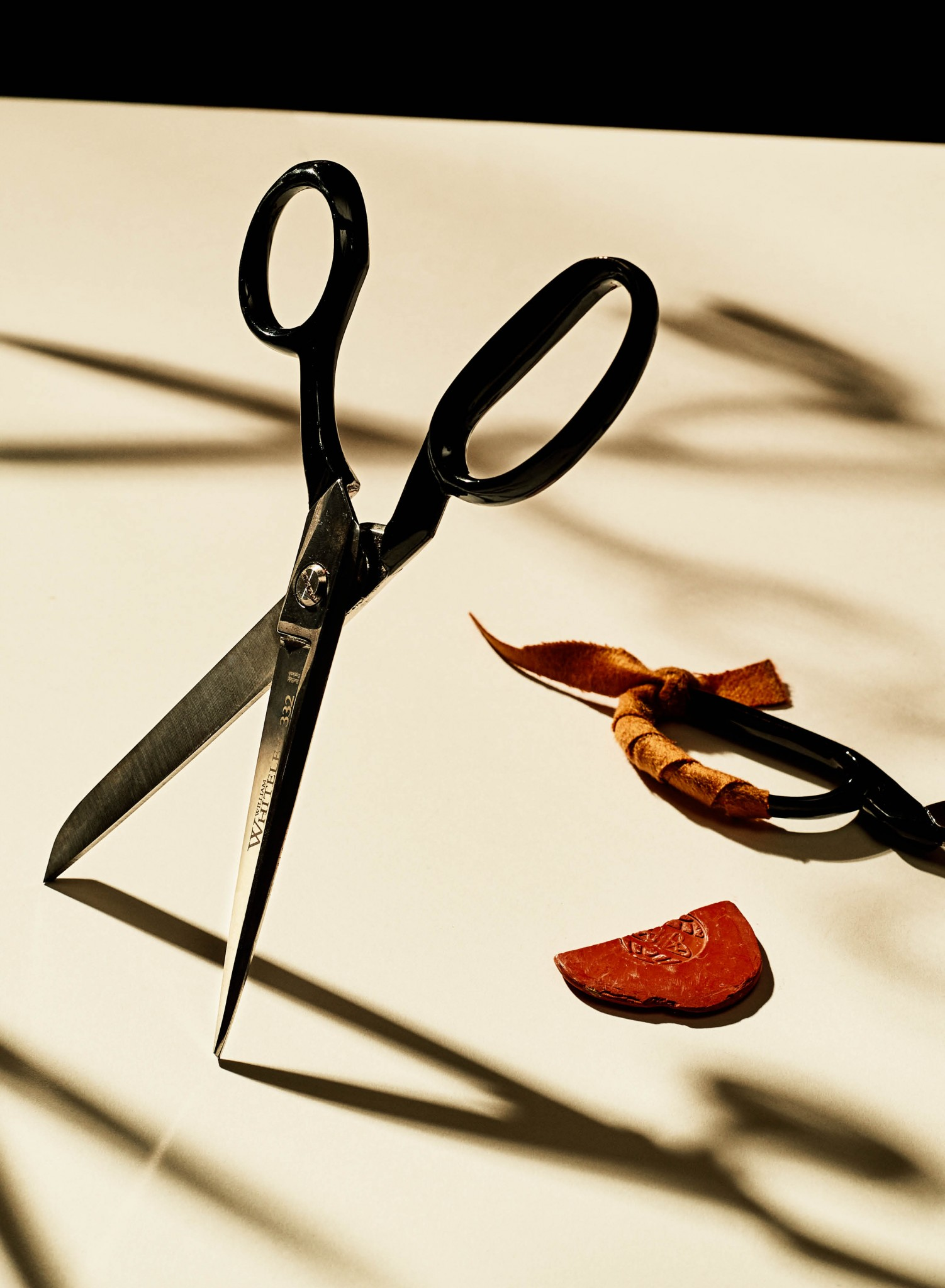 Closeup image of fabric scissors and tailor chalk
