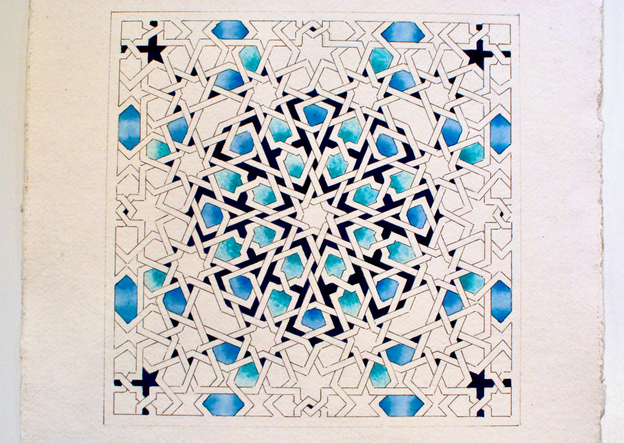 A photo of a geometric pattern in different shades of blue