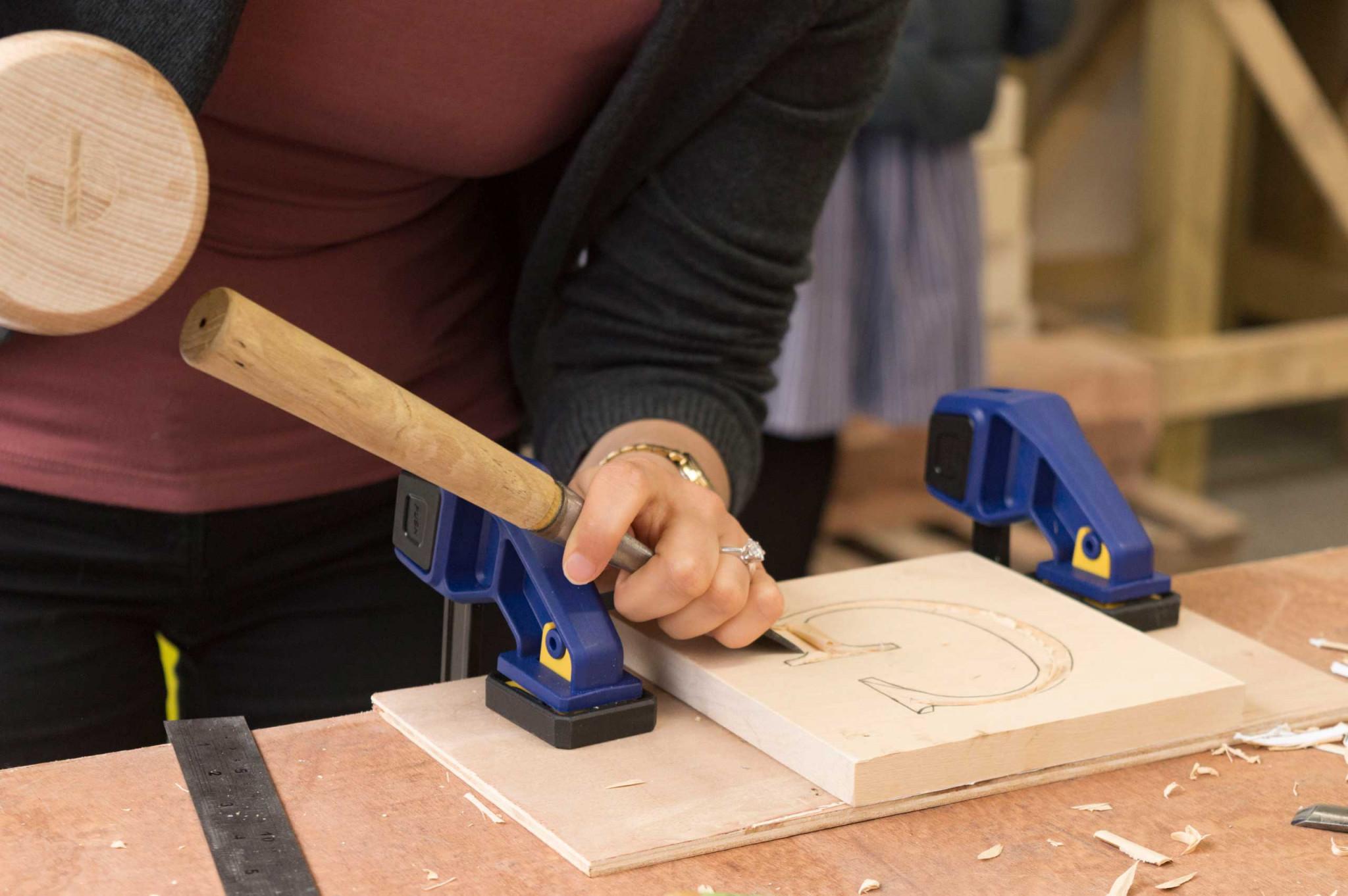 An image of Sarah Goss carving